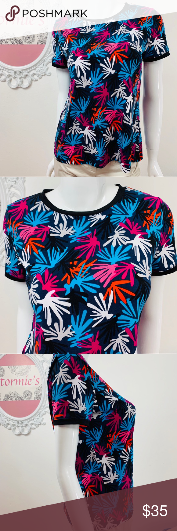 Anne Klein / Black Pink Blue Purple Orange White Anne Klein black with fun pops of color. . Button up back. 94% polyester 6% Spandex gives a little extra stretch.   size M Bust 19in. Length 25in.  ➡️Bundle 2 or More items for a Extra Discount!!!! ➡️I am open to all Reasonable Offers!!! 👍So Bundle your Items and Send me a Offer 👍 #0317 Anne Klein Tops Blouses