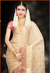 Fawn soft mysore silk self and zari weaved saree.