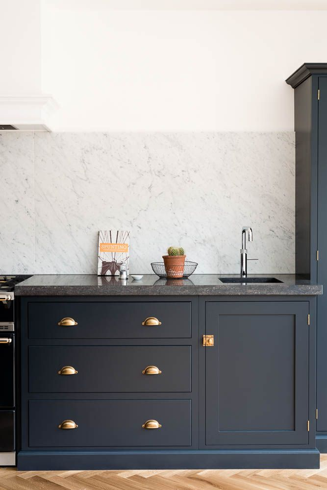 belgian blue fossil worktops and a huge carrara marble splashback make this shaker kitchen. Black Bedroom Furniture Sets. Home Design Ideas