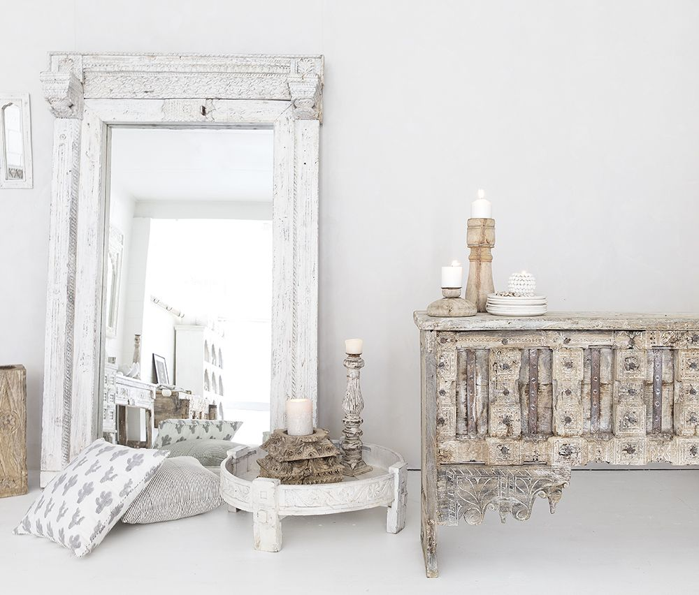 We source old pieces from India and have them refinished in an all-white palette.