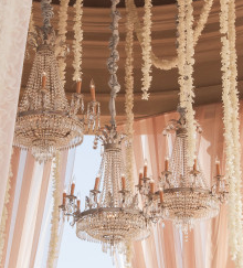 Vintage hanging chandeliers with fresh flowers extending from ceiling.  Visit our website for our wedding and event planning services  www.topshelfevents.co.za  Wedding planners cape town  Event planners cape town