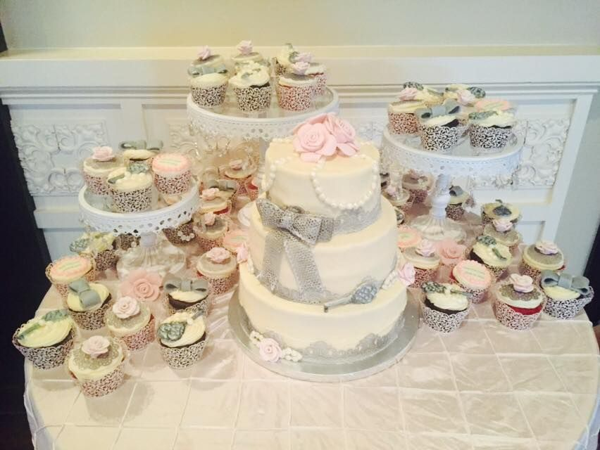Vintage Victorian three tiered cake with matching custom cupcakes.  Decorated with edible lace, pearls, and roses.
