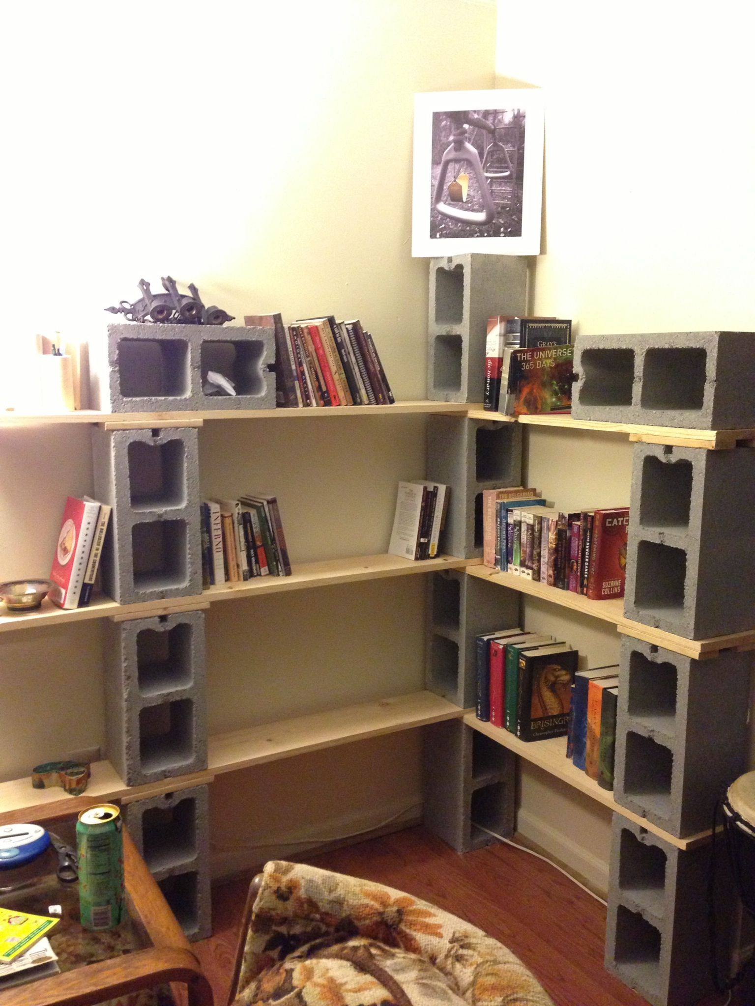 book shelve made from six cinder block and two plank of wood
