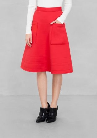 SADIE WILLIAMS Smooth semi-structured fabric with a light padded feel is crafted into this solid midi skirt featuring patch pockets, decorative stitching and the feminine A-line silhouette.