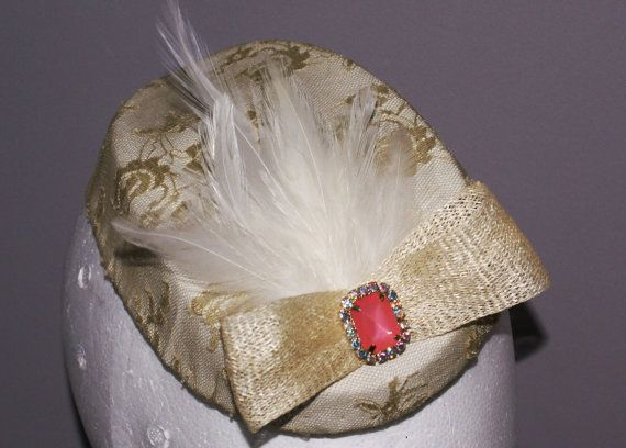 white and light gold feathered headpiece with by GwinnuttMillinery, £58.00