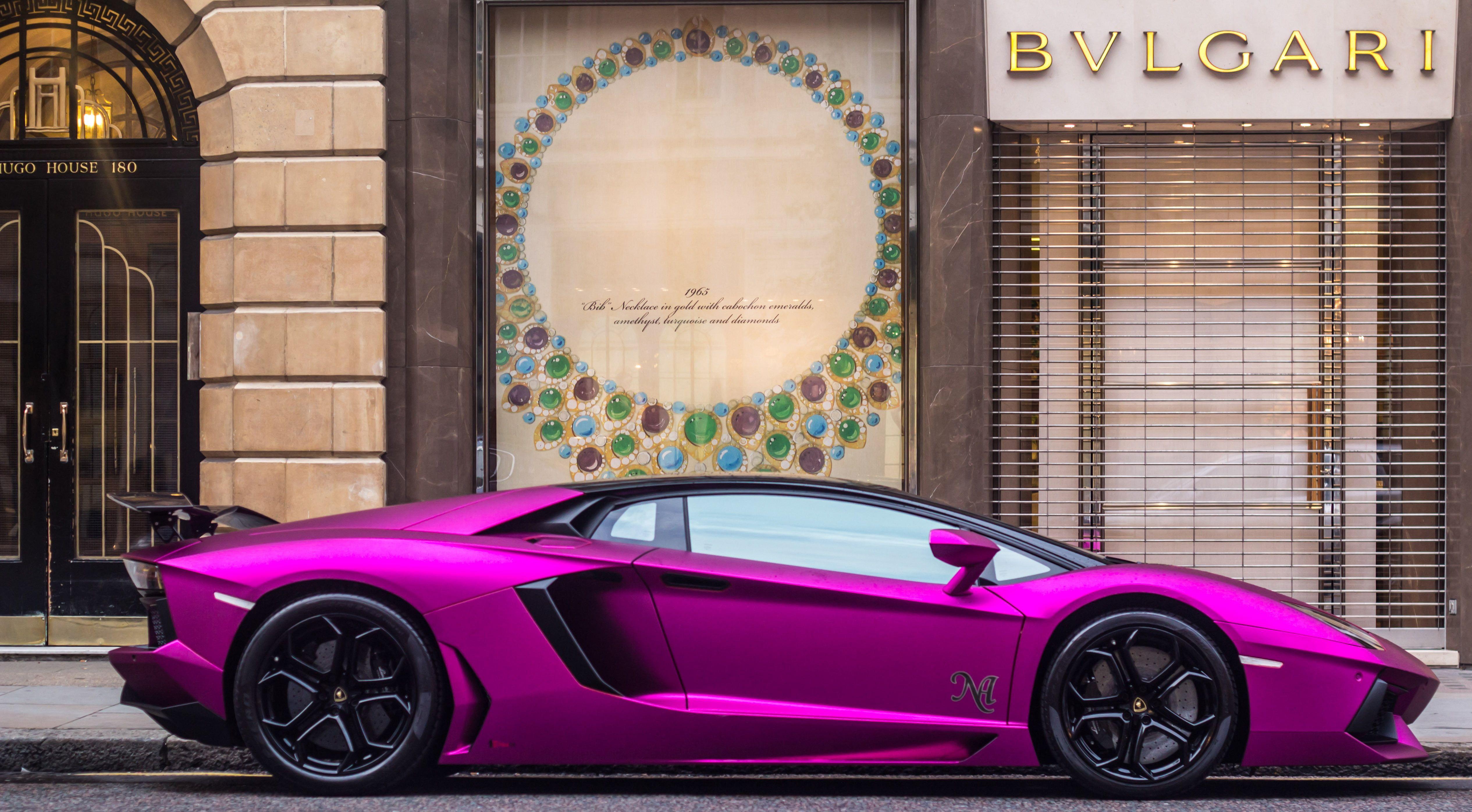 purple sports car near Bvlgari store Lamborghini  Aventador sports Car land Vehicle