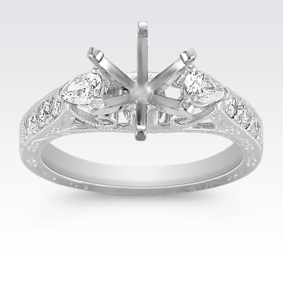 This vintage inspired engagement ring is sure to make a statement.  Two pear-shaped diamonds, at approximately .27 carat TW, are accented with six round diamonds, at approximately .21 carat TW.  These shimmering gems are set in superior quality platinum and features lovely milgrain detailing.  Add the center stone of your choice to complete this beautiful look. The total gem weight is approximately .48 carat.