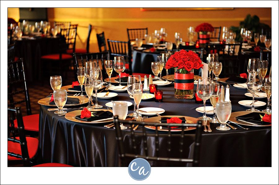 Black and red wedding reception decorations with red roses at each ...