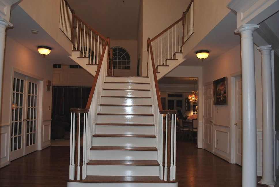 2 Story Foyer Decorating Ideas look at round columns and the header over the columns. .don't like