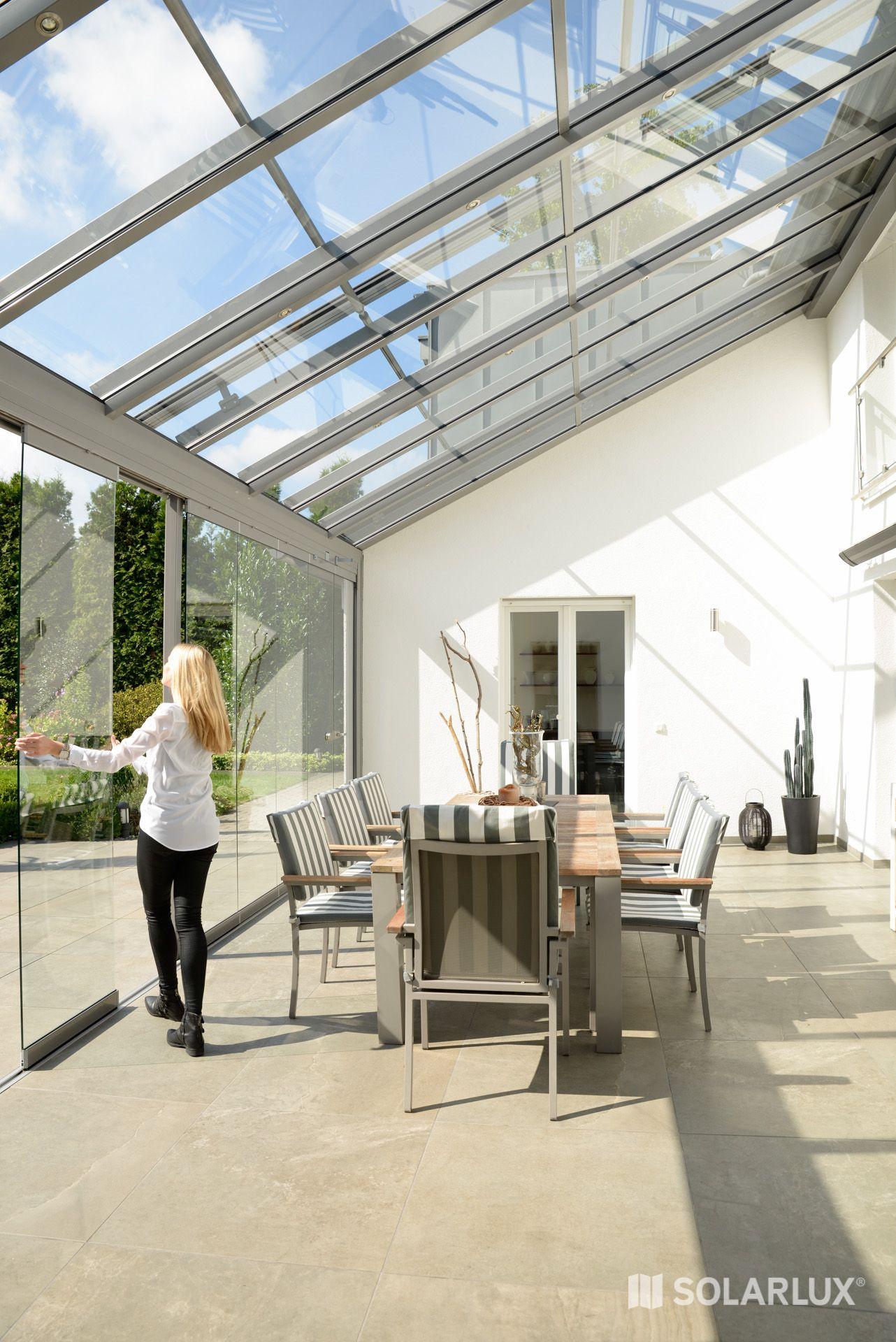 Das Terrassendach SDL Atrium ergibt mit den SL 25 Glas Schiebe