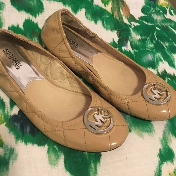 Michael Kors - beige leather flats MICHAEL Michael Kors - beige leather quilted flats with silver MK embellishment on each shoe, fits easily in your purse! Michael Kors Shoes Flats & Loafers
