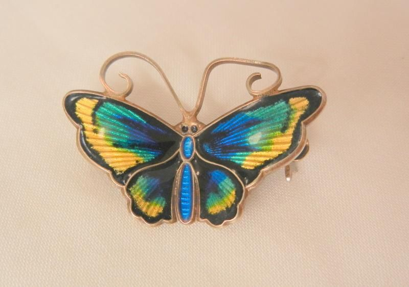Gorgeous small David Anderson sterling Norway enamel butterfly brooch is in excellent vintage condition. The colors are saturated rich deep blues,