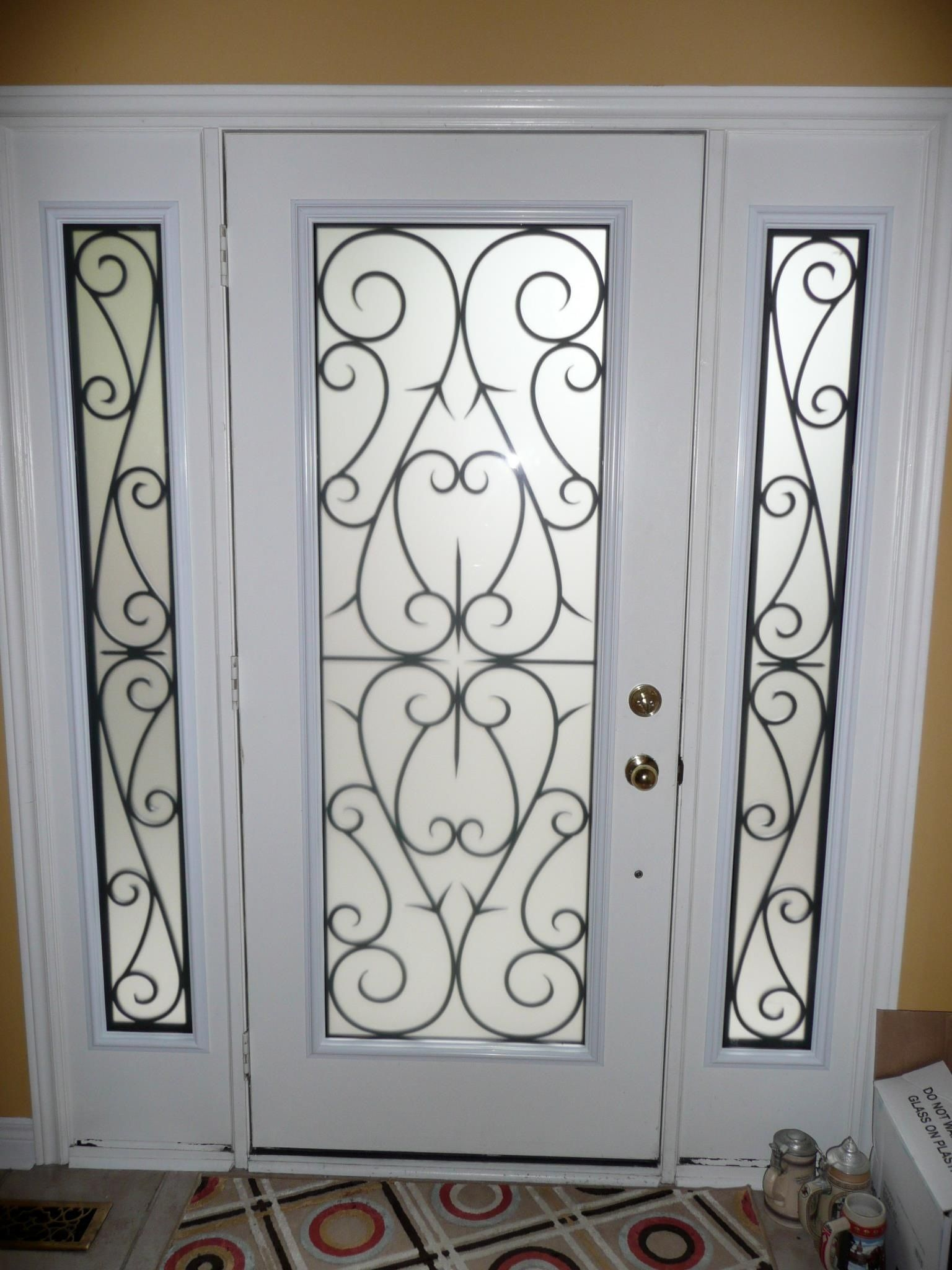 Decorative glass inserts for doors wrought iron for Wrought iron front doors