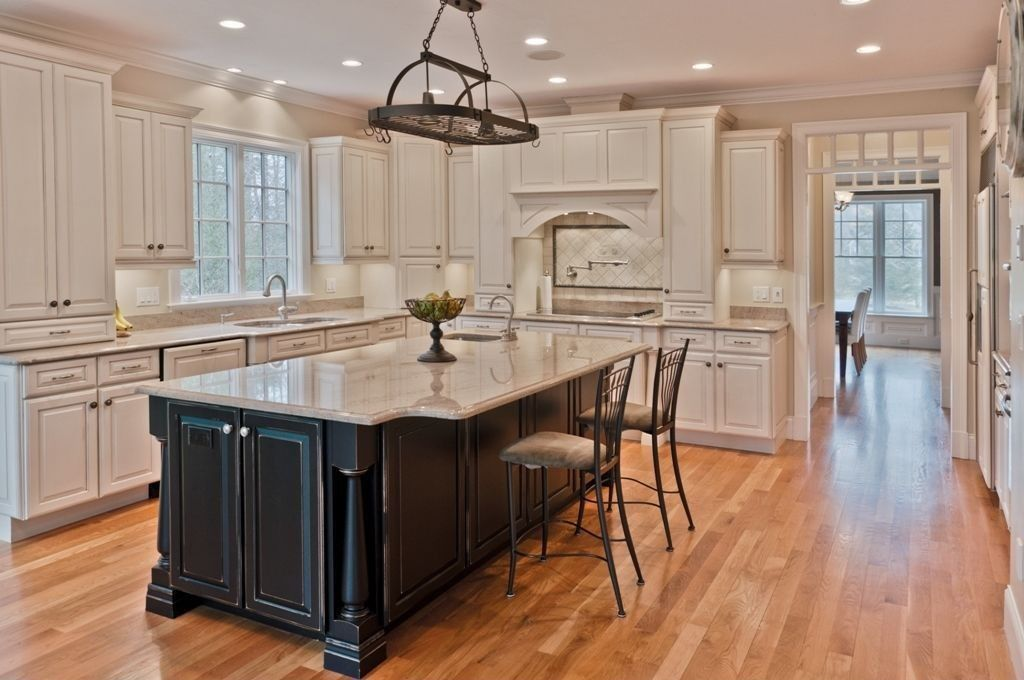Zillow digs spring trend report traditional kitchens for Dark kitchen cabinets with light island