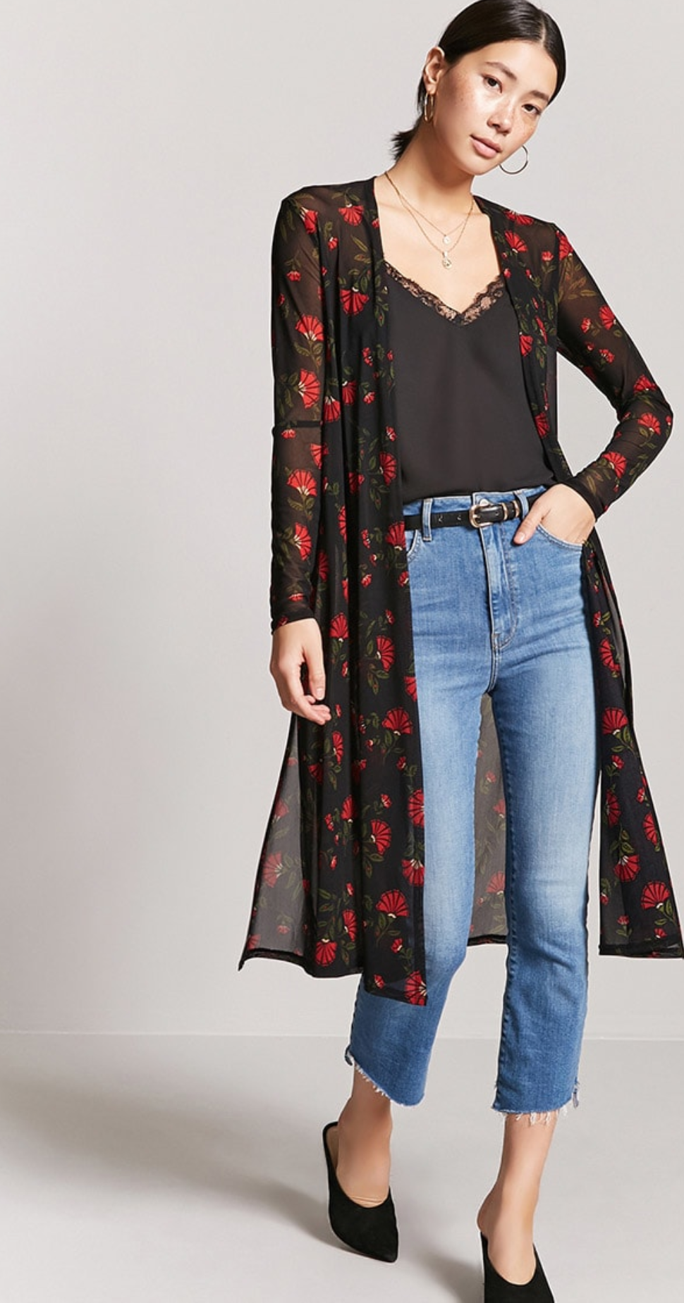 b01bc58c2 A sheer mesh knit kimono featuring an allover floral print, open-front  design, long sleeves, side slits, and a longline silhouette