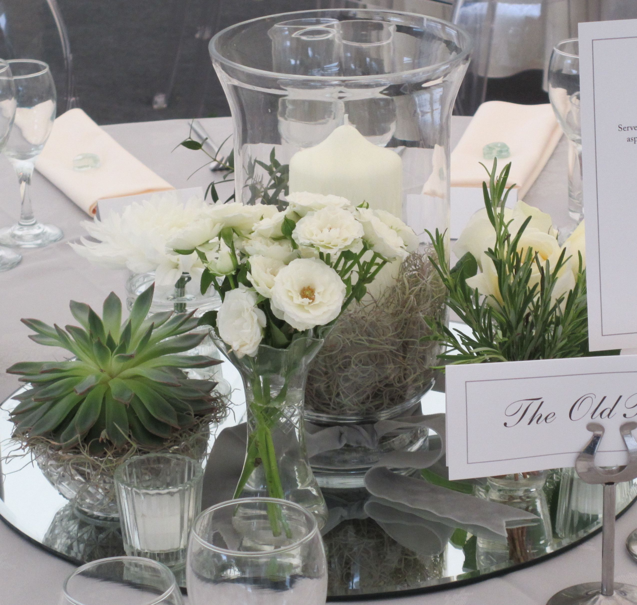 Table Decoration With Mirror Glass, Succulents, Storm Lantern And Grey
