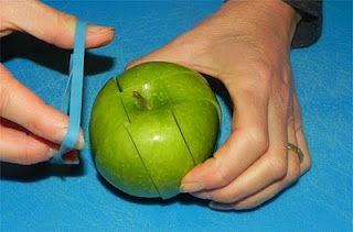 To pack a cut apple into a lunch, reassemble cut sides together and secure with a rubber band.  Won't turn brown!