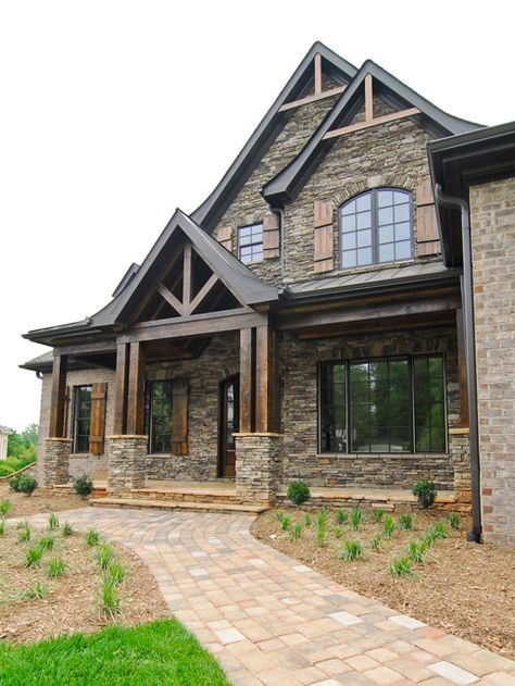 Exterior Milestone Custom Homes New Casa Exterior Pinterest - A warm stone exterior houses an intimate residence and private art gallery