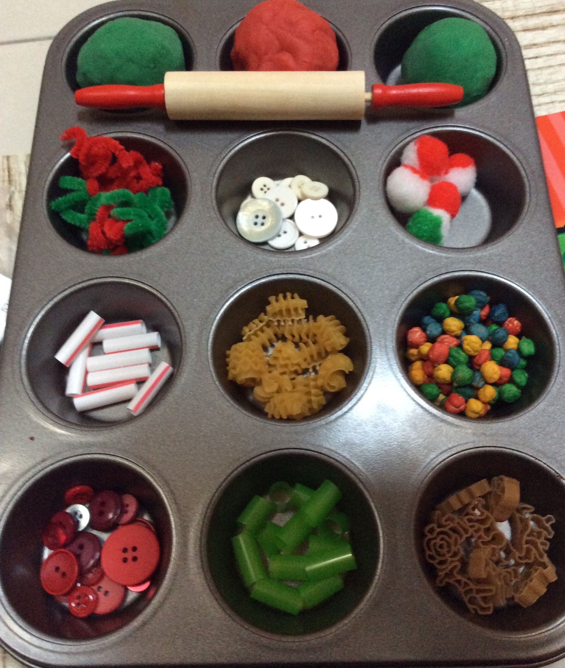 "Playdoh play kit for Christmas. Lots of ""cookie"" or tree decorations in a covered muffin tin"