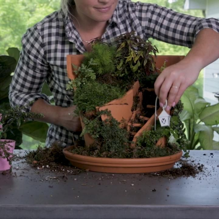 Transform a broken clay pot into something stunningly impressive with this fairy garden idea. We stuffed our broken pot garden with colorful succulents, moss, and a wishing well—but you can customize your potted fairy garden to fit your personal style. Here's how to make this fairy garden out of a broken pot. #boredathome #diyfairygarden #brokenpot #fairygarden #bhg