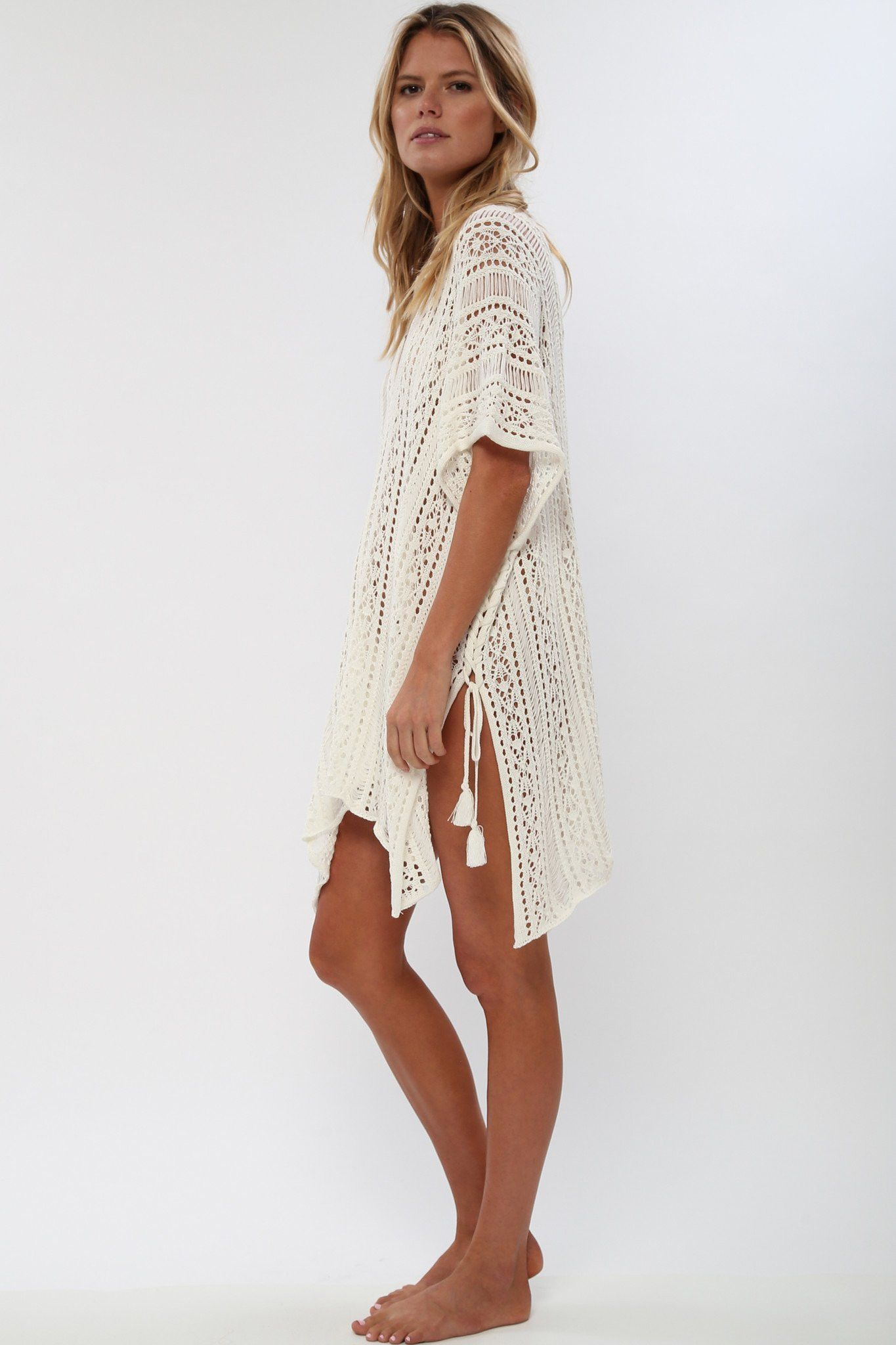 d74972a312 A semi-sheer woven cover-up featuring crochet style all-over