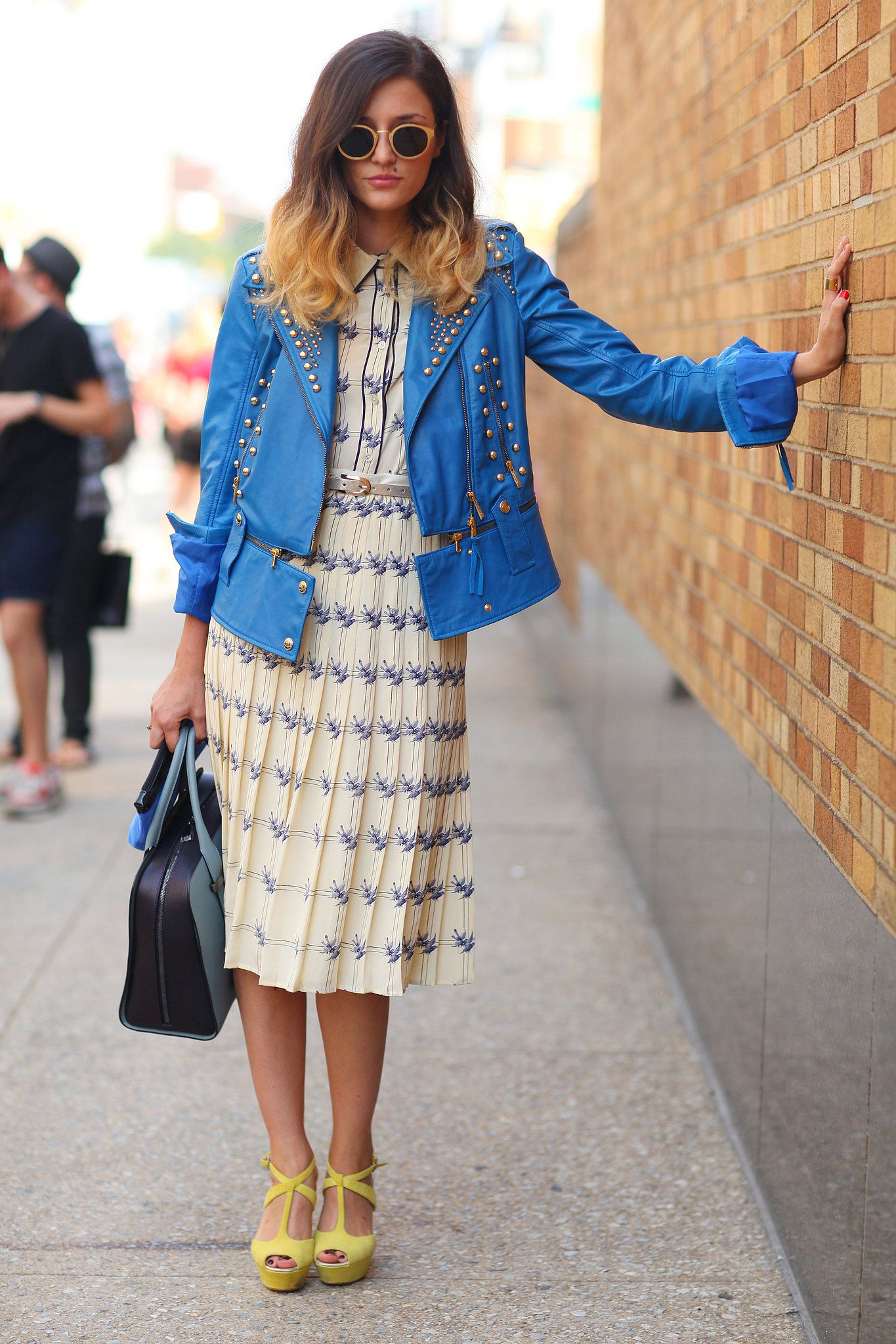 Style Inspiration: The Best Street Style at NY Fashion Week Spring 2014 >> A little retro-feeling dress topped with a not-so-retro studded jacket added up to a serious style moment.