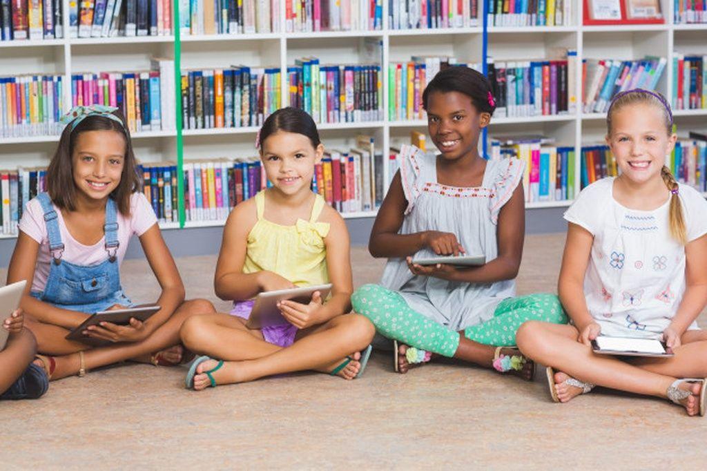 School Kids Sitting On Floor Using Digital Tablet In Library Paid Ad Sponsored Sitting Floor Library Kids