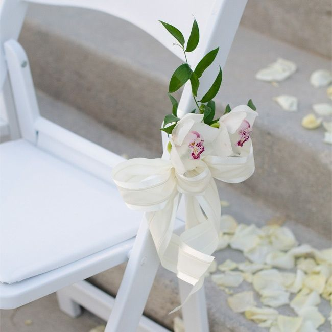Simply Beautiful -white Flowers Were Tied To The Ceremony