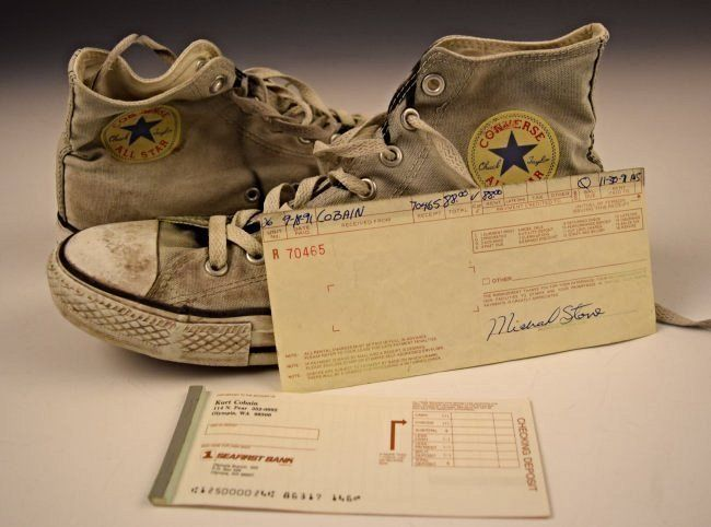 Kurts Converse sneakers, his checking slips, and receipt for