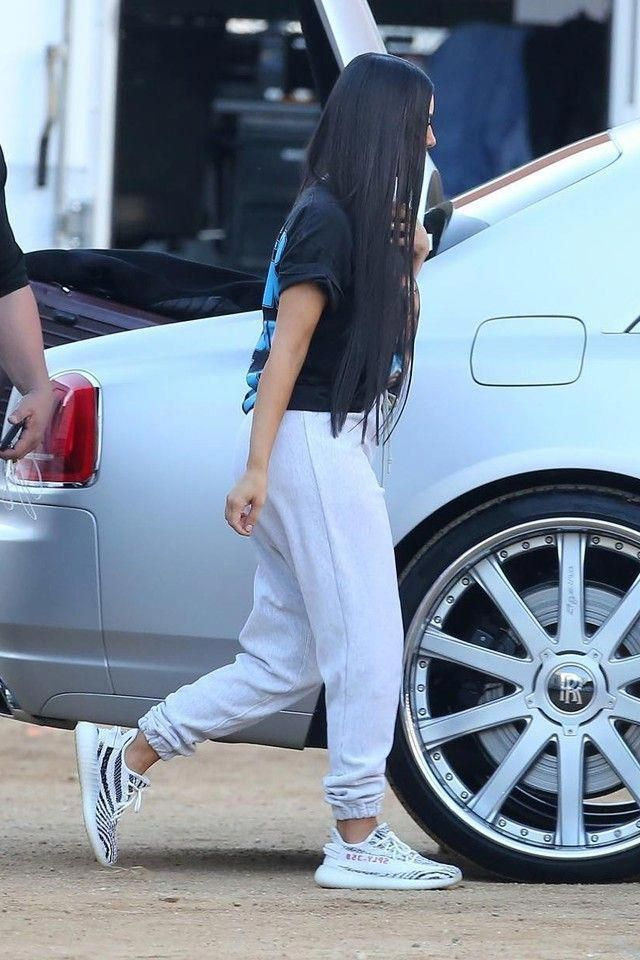 Kim Kardashian wearing  Vintage Snoop Dogg T-Shirt, Adidas Yeezy Boost 350 V2 zebra #reconstructive #kimkardashianstyle
