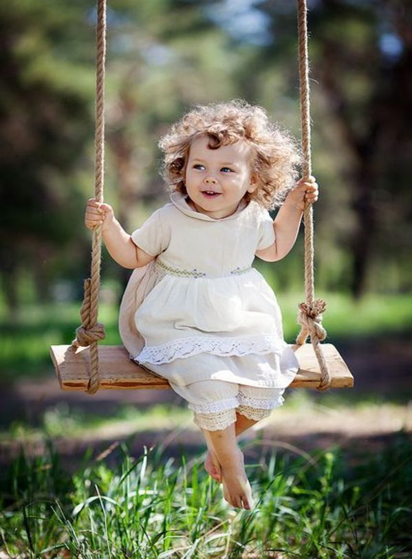 Letting Those Curls Fly In The Wind Just Swinging Without A Care Beautiful Children Precious Children Cute Kids