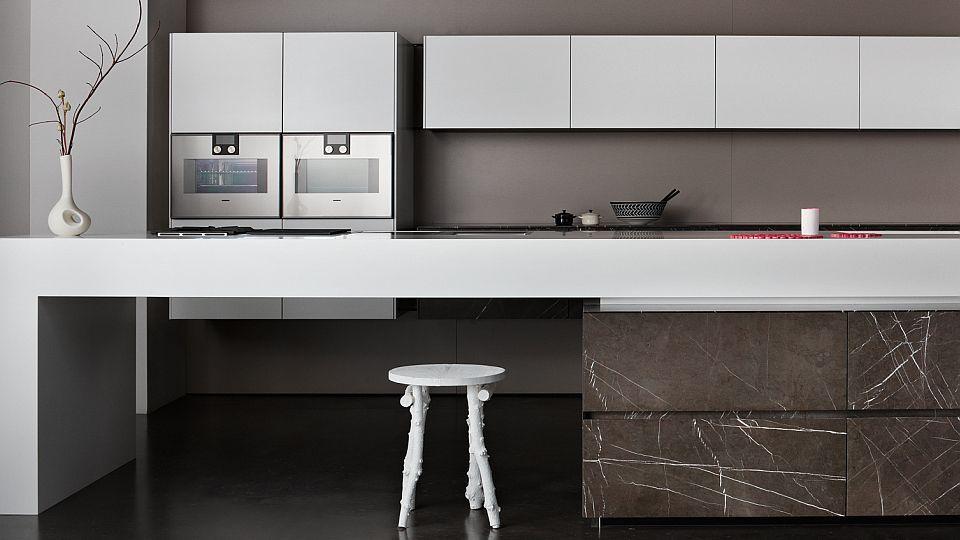 Eggersmann Küchen contemporary kitchen corian limestone island grafite brown