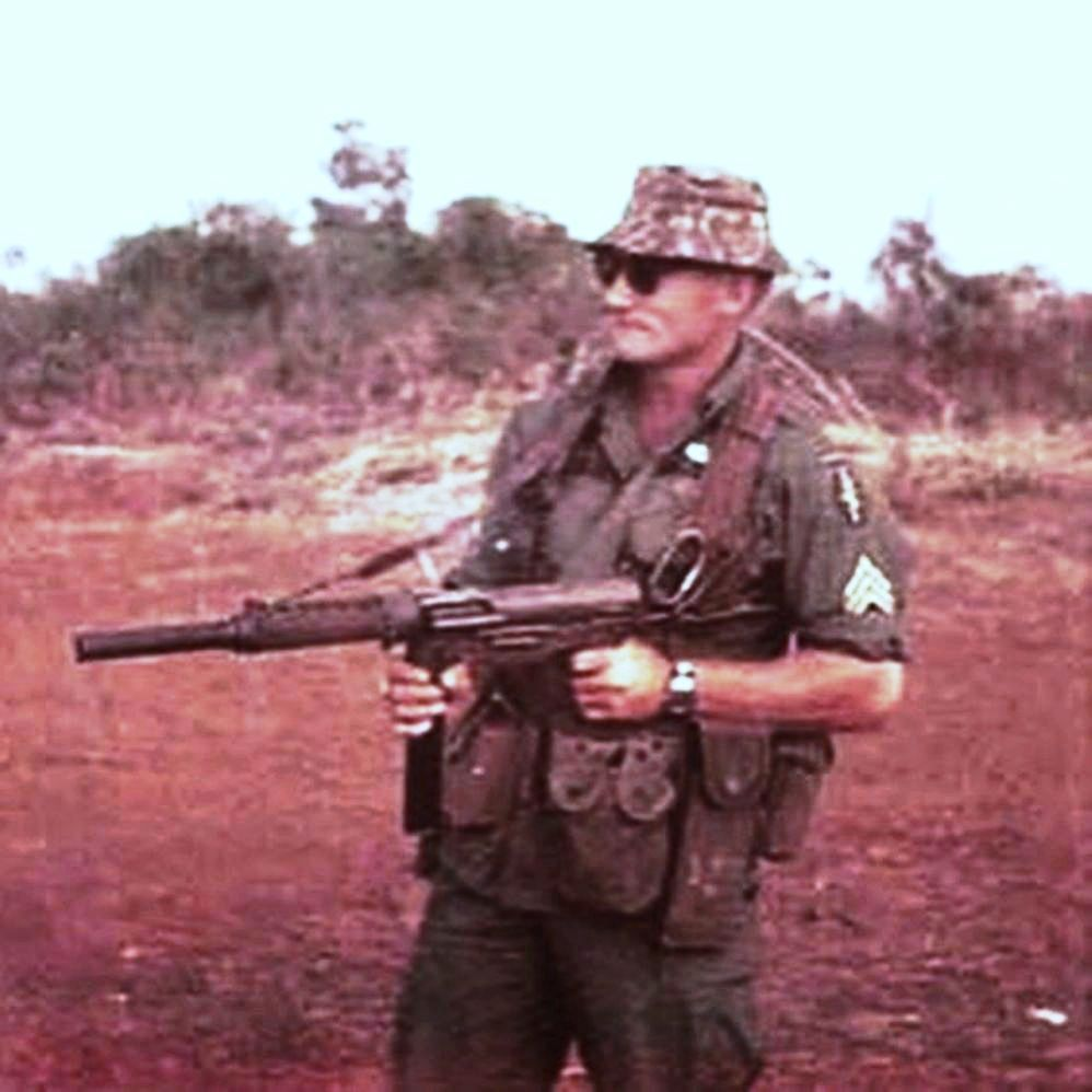 A Special Forces Sgt  shows off his grease-gun  | Vietnam military