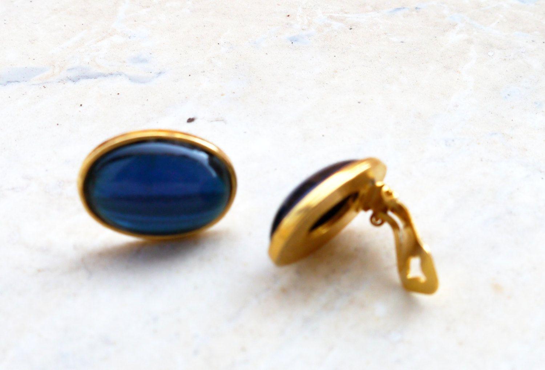 Vintage gold tone clip on earrings, faux blue stones by BelledeJourVintage on Etsy