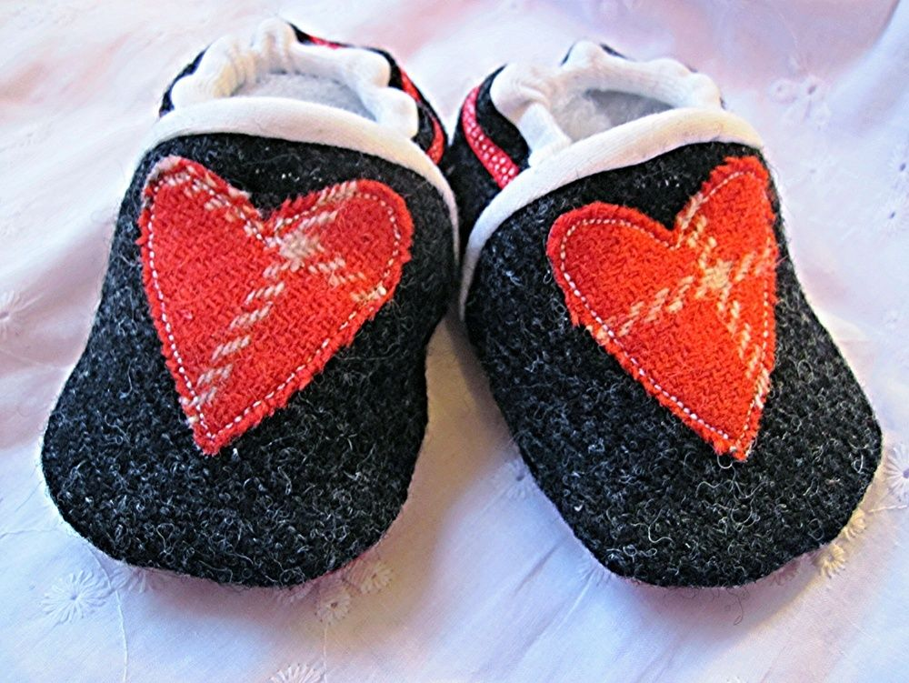 Charcoal Harris Tweed with red heart detail and red leather sole.Size 0-6 months. Other sizes available to order - please email to enquire.Trims and pattern placement may vary.