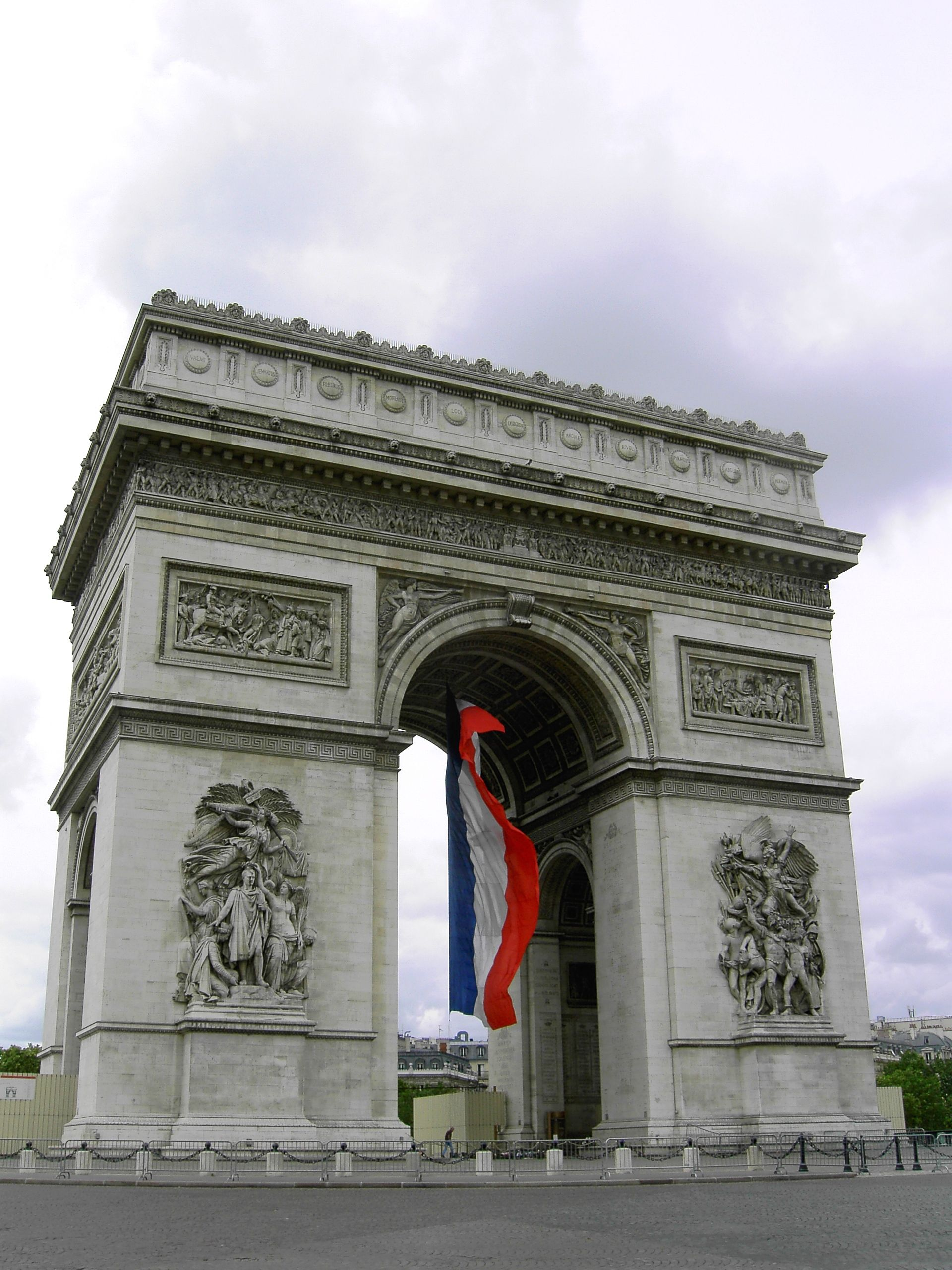 Famous French Architects arc de triomphe, paris, france, with the french flag, view from