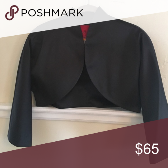 Black Bolero Jacket Mint condition Asian inspired JS Collections black bolero jacket. Everything about it is perfect. I wore it over a strapless dress to a formal event, but have not worn it since. It is a true bolero jacket, short, no buttons, with a slightly raised collar. Very smooth lines and it's beautifully made and lined. It is listed as a size 12, i'm a size 4 and I wore it. JS Collections Jackets & Coats