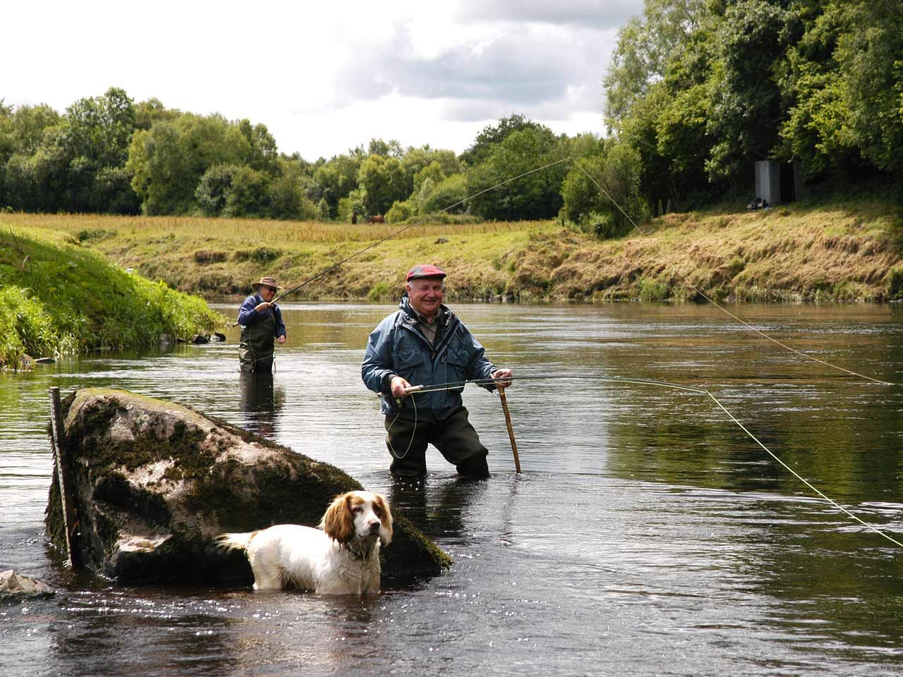 Two Guys Fly Fishing With Their Pooch Ireland Fly Fishing Gone Fishing Fish