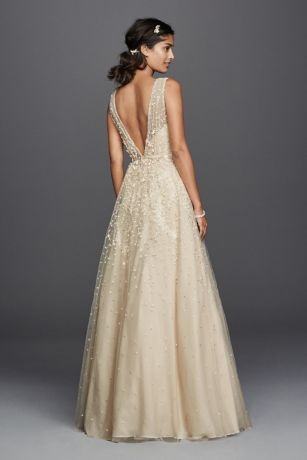 e6223c9653a The plunging V-neckline and V-back on this tulle A-line wedding dress make  a chic and sexy statement