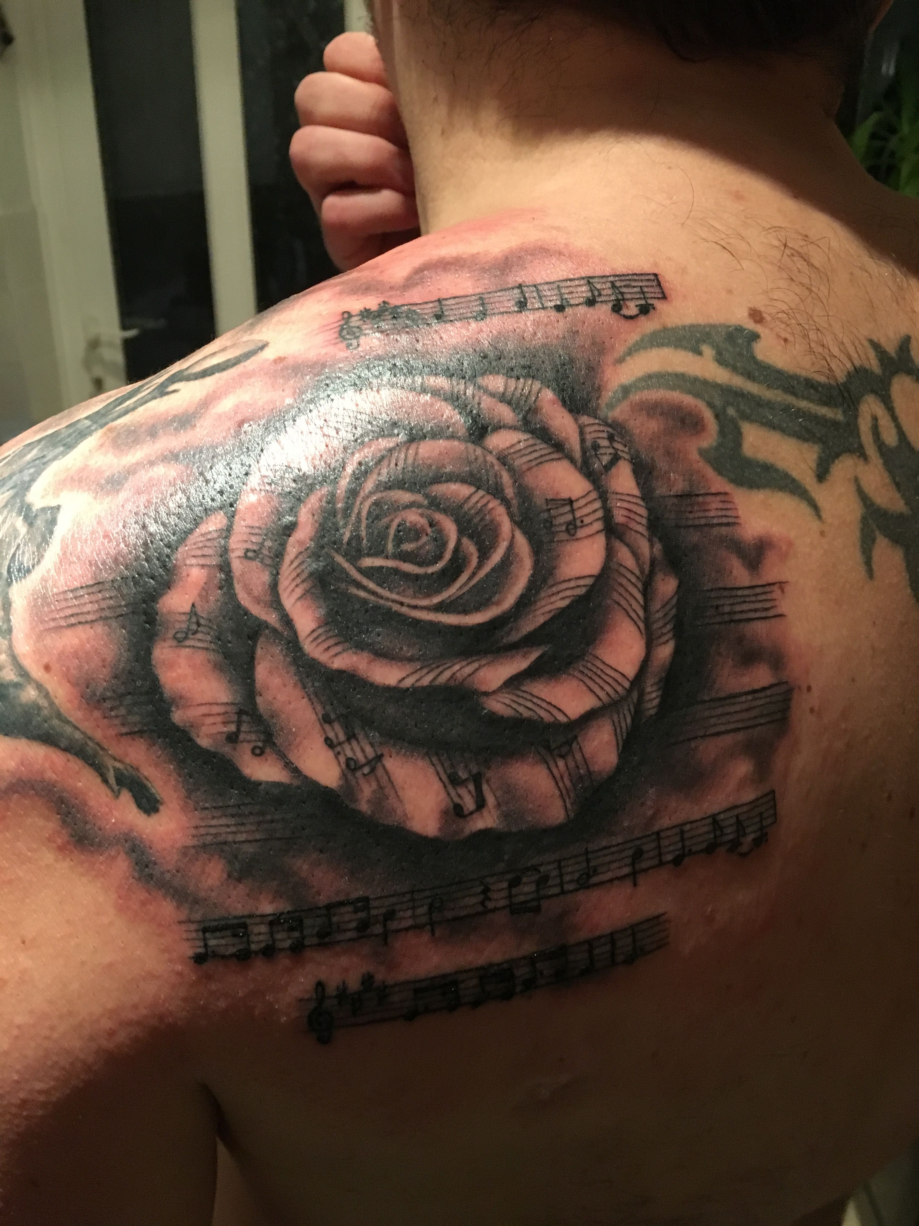 Rugby rose tattoo, swing low