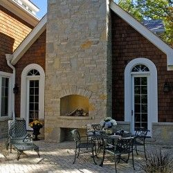 cedar shake shingle stone chimney and outdoor fireplace