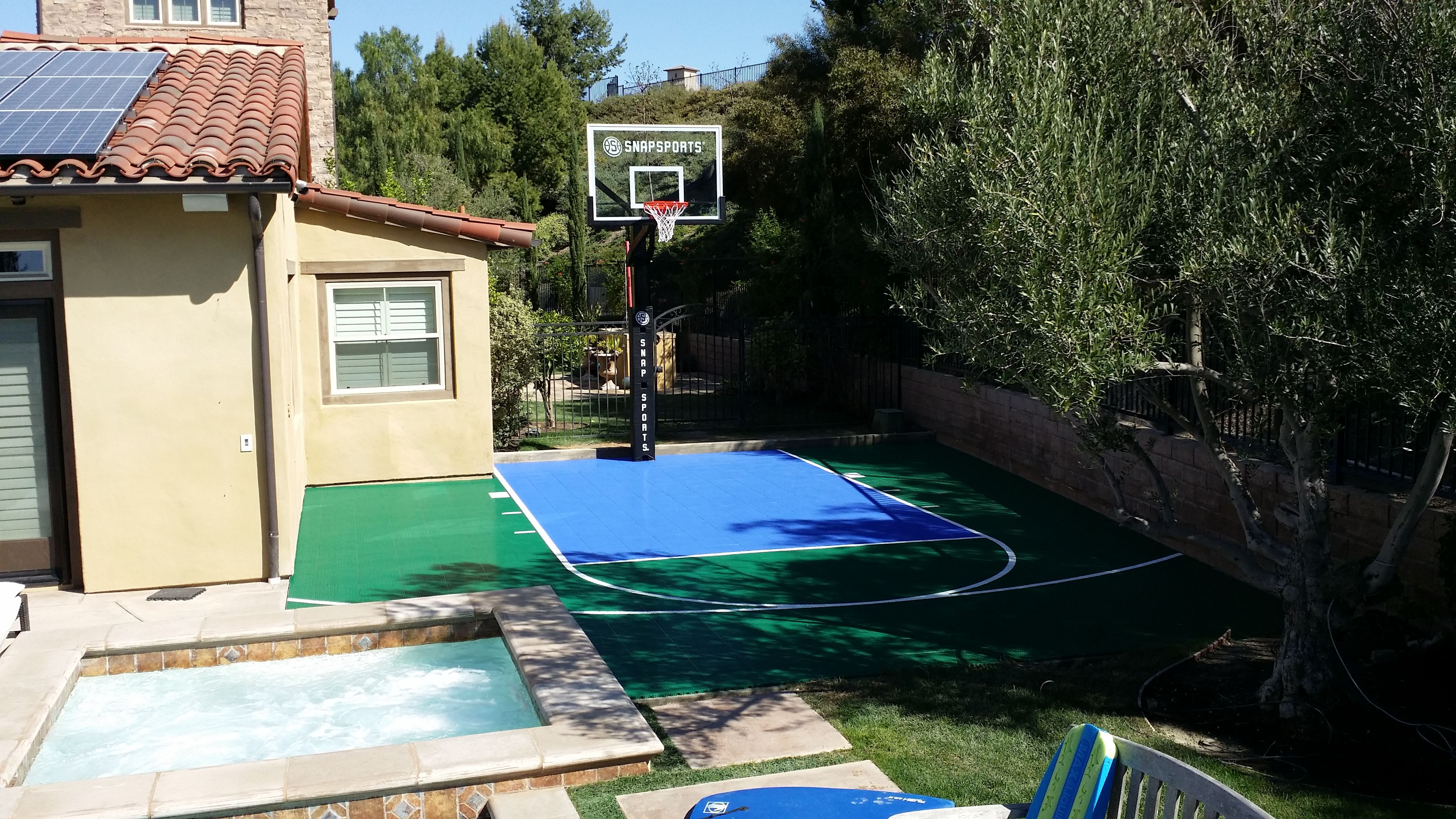 this small backyard is now a great sports zone complete with a