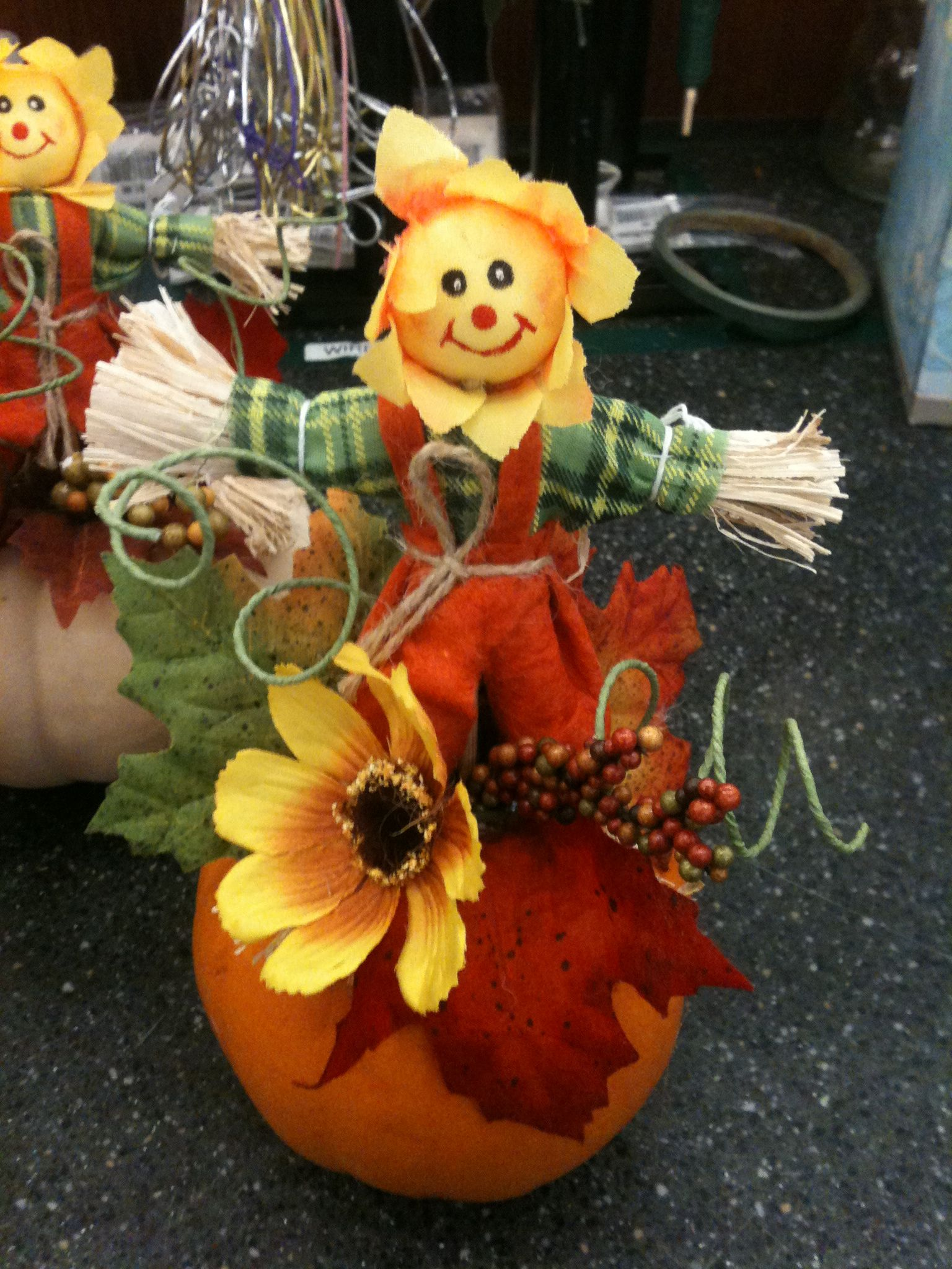 Mini pumpkins with scarecrows