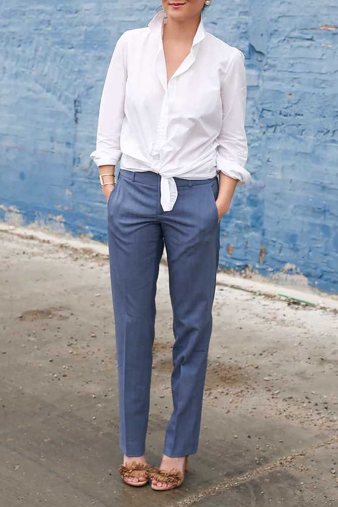 ee95302d90886 Jennifer Lake keeps her look polished in our white button down shirt and  chambray wool straight leg pants
