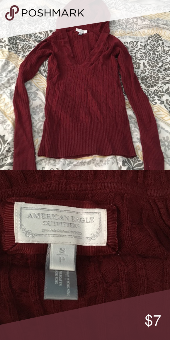Aeropostale hooded sweater Great sweater, like new condition. V neck, not really my style. Preloved from another posher. Maroon in color Aeropostale Sweaters V-Necks