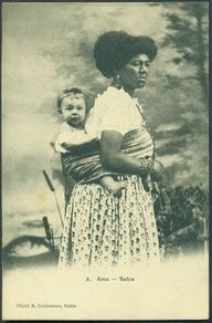 Brazil, 1880: slave woman carrying her masters baby in the traditional african way. Photo by Rodolpho Lindemann.
