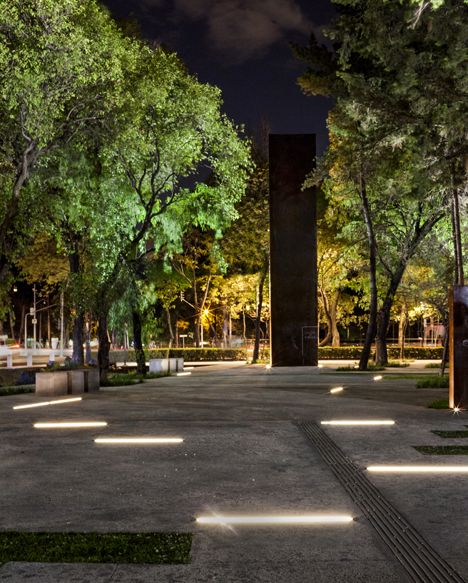 Memorial to the Victims of Violence by Lighteam, illumni. In grade linear site lighting.