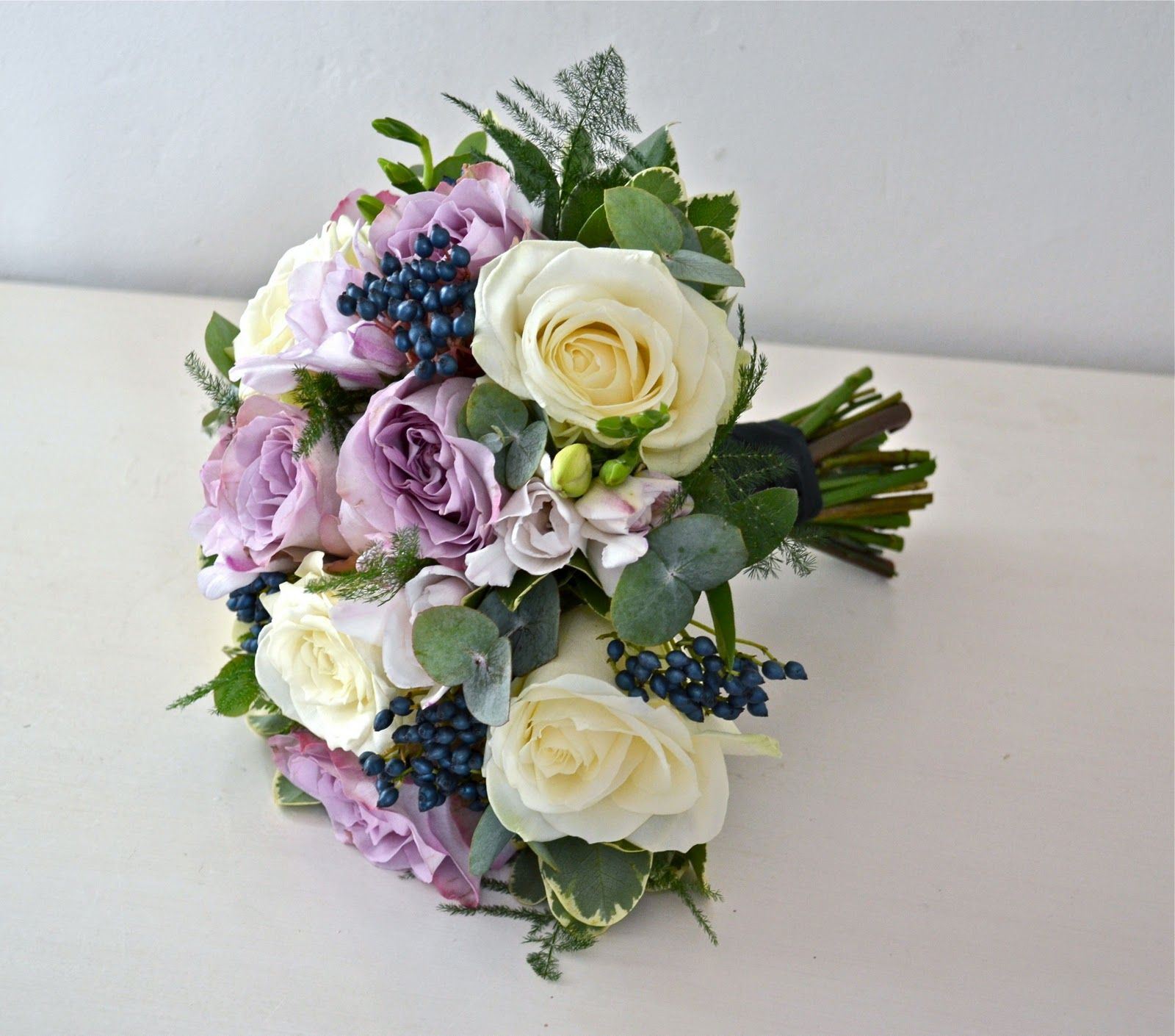 Mauve flowers for wedding winter vintage bouquet mauve ivory and mauve flowers for wedding winter vintage bouquet mauve ivory and black roses izmirmasajfo