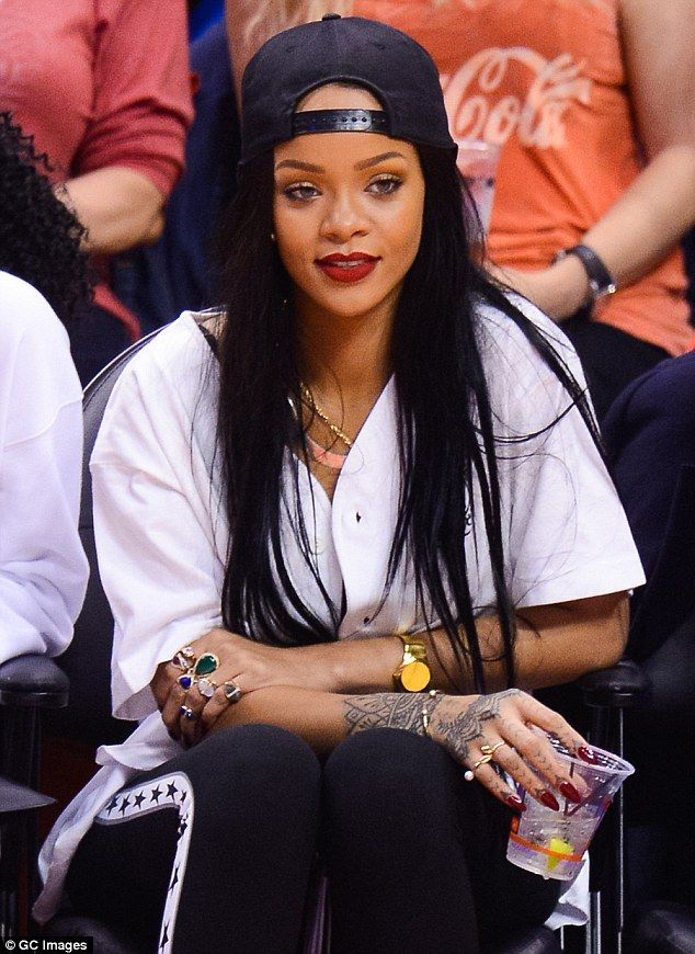 Rihanna covers up for a change as she watches Los Angeles
