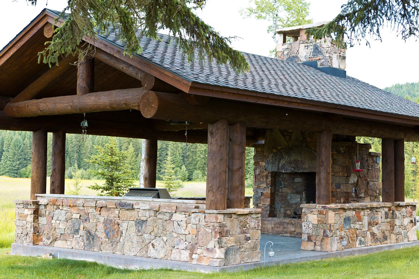 Entertainment pavilion with the outdoor kitchen at either the